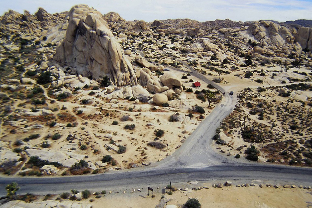 A 1970s aerial view of the Old Woman taken on top of Intersection Rock. This photo shows the old access road to Hidden Valley Campground | Tony Yeary