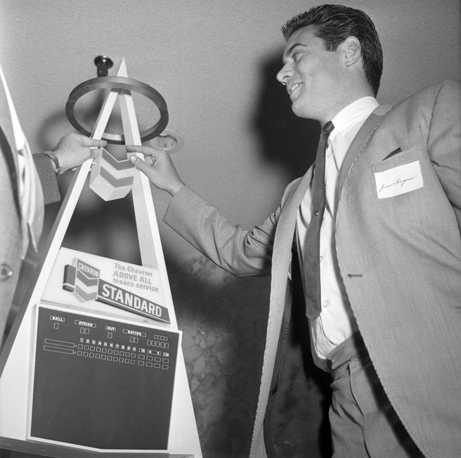 Angels shortstop Jim Fregosi with a model of the Big A scoreboard. The team's players supported the move since they found Dodger Stadium's quick infield and pitcher-friendly dimensions ill-suited to the team's style.