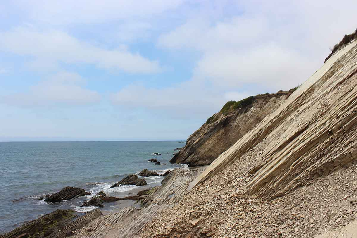 A rocky mountain leading down to the shore near Hollister Ranch. | Spencer Robins