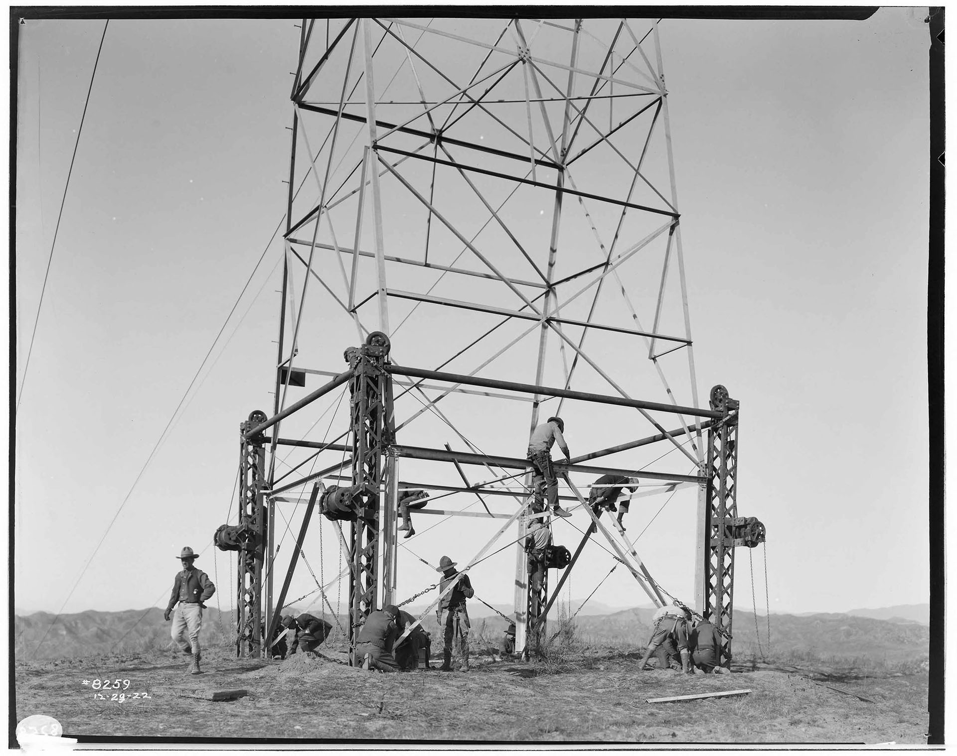 Big Creek Transmission Line - Raising Towers for 220kV transmission. SCE_02_08259. 	Southern California Edison Photographs and Negatives. The Huntington Library, San Marino, California