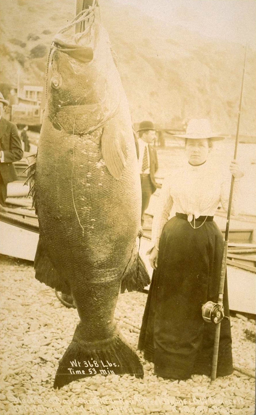 A tuna hanging out with a woman.