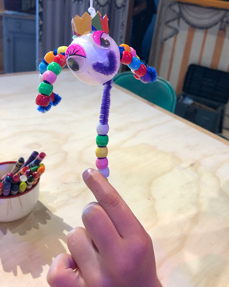 A child holds up a puppet made at the OxyArts and Kidspace Summer Camp in 2019. | Courtesy of Missy Steele