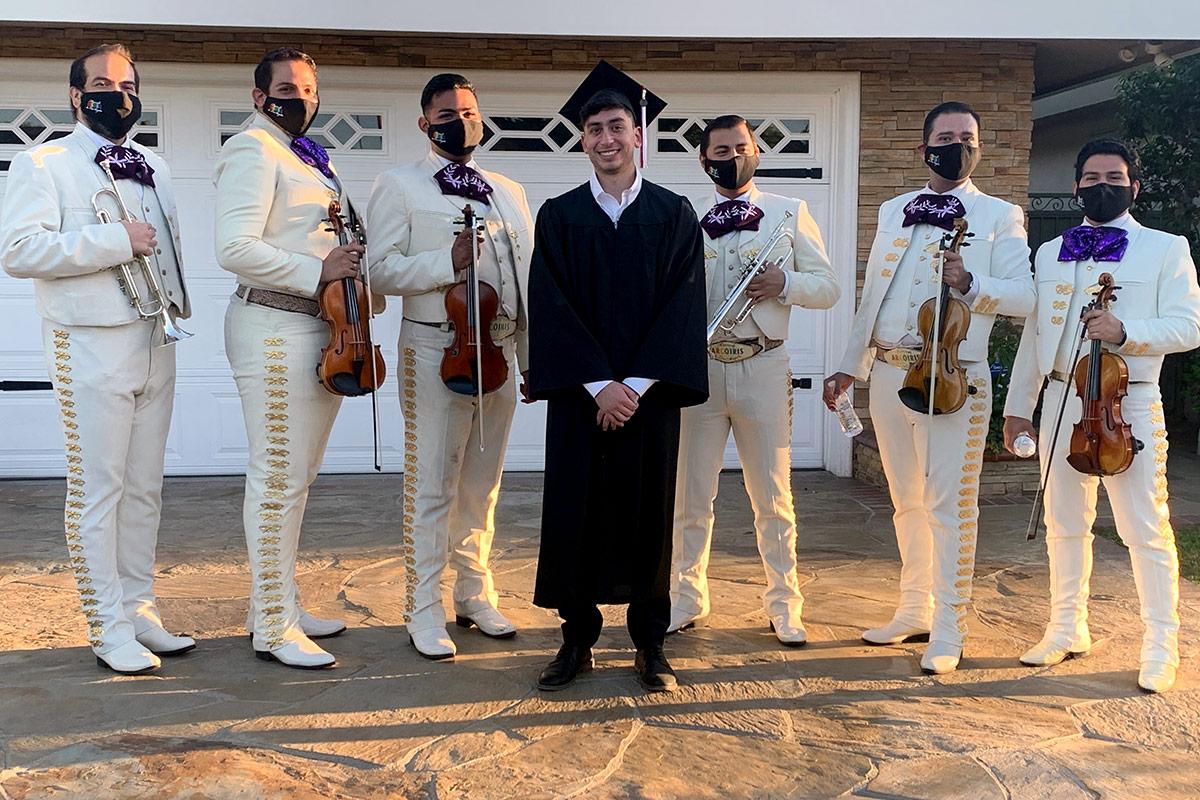 Mariachi Arcoiris de Los Angeles Members pose in face masks at a recent graduation gig. | Courtesy of Carlos Samaniego