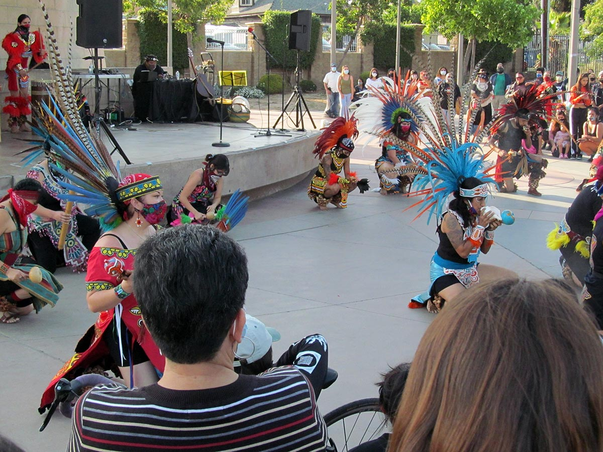 Several danzantes give a danza presentation at a Juneteenth celebration in Boyle Heights' Mariachi Plaza   Anthony Nittle