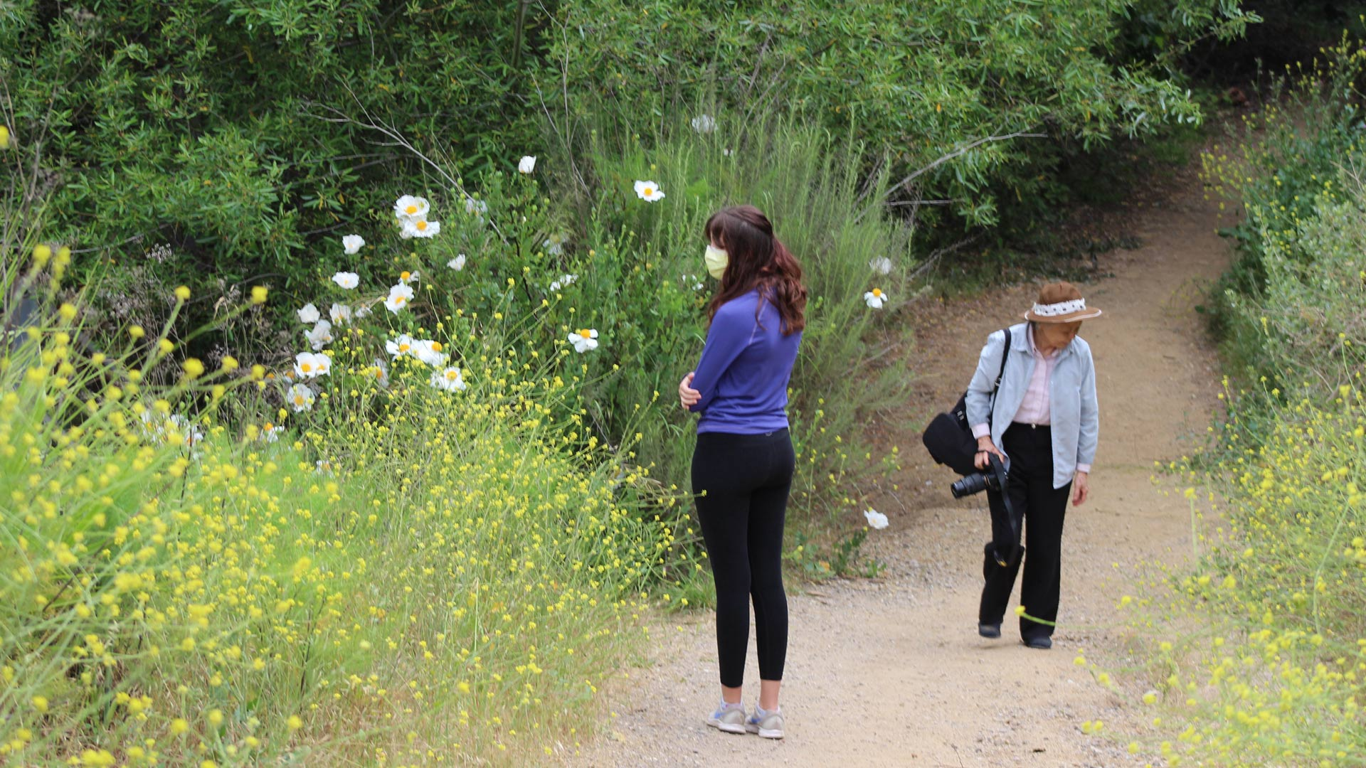 Two women walk in Temescal Canyon, May 9. 2020, the first day L.A. City and County trails are reopened. | Karen Foshay