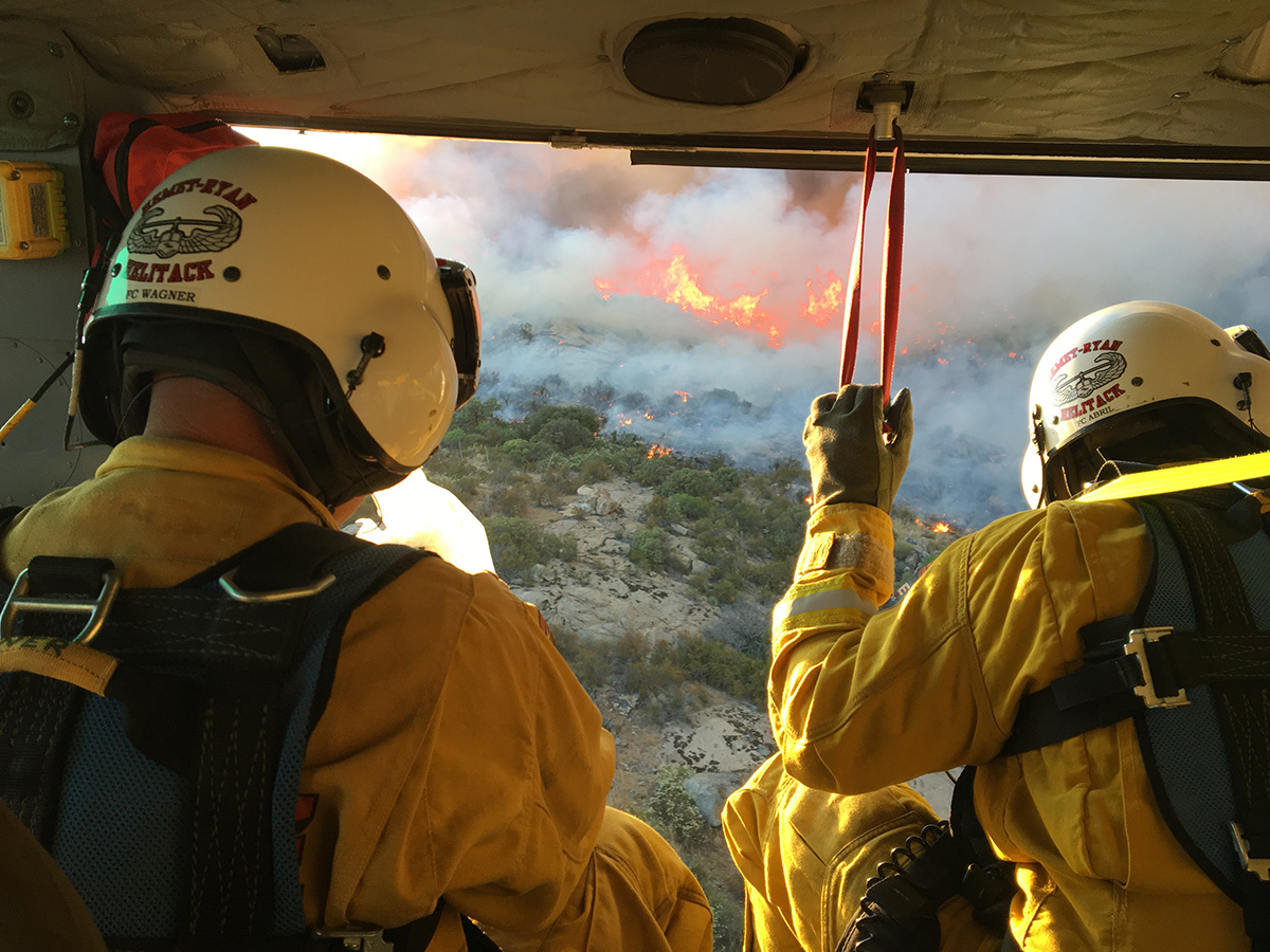 Two firefighters survey a fire from the sky. | Courtesy of Cliff Walters