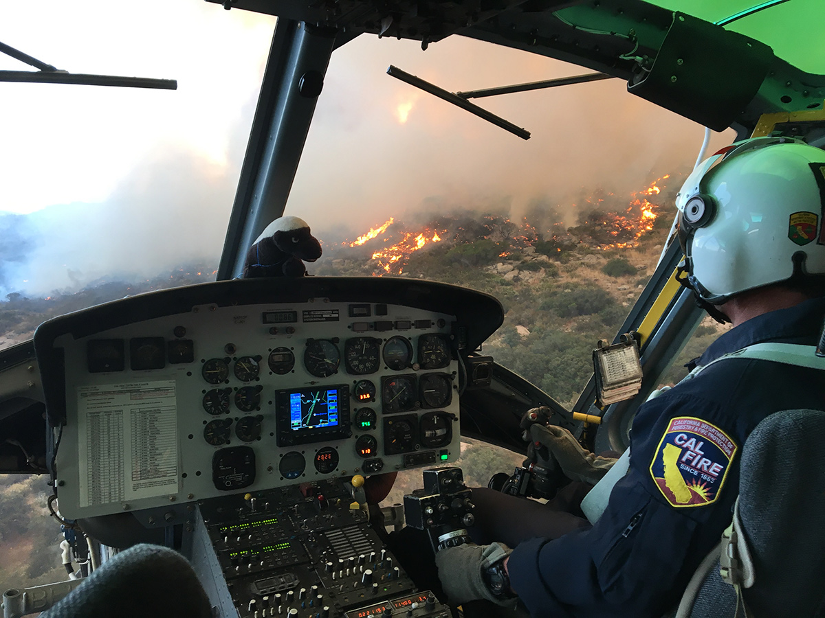 A helicopter pilot flies over a fire. | Courtesy of Cliff Walters