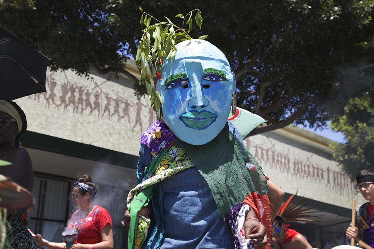 A person walk in a large blue mask at the 2017 edition of the Day of the Ancestors: Festival of Masks. | Photo by Sahra Sulaiman, Courtesy of LA Commons