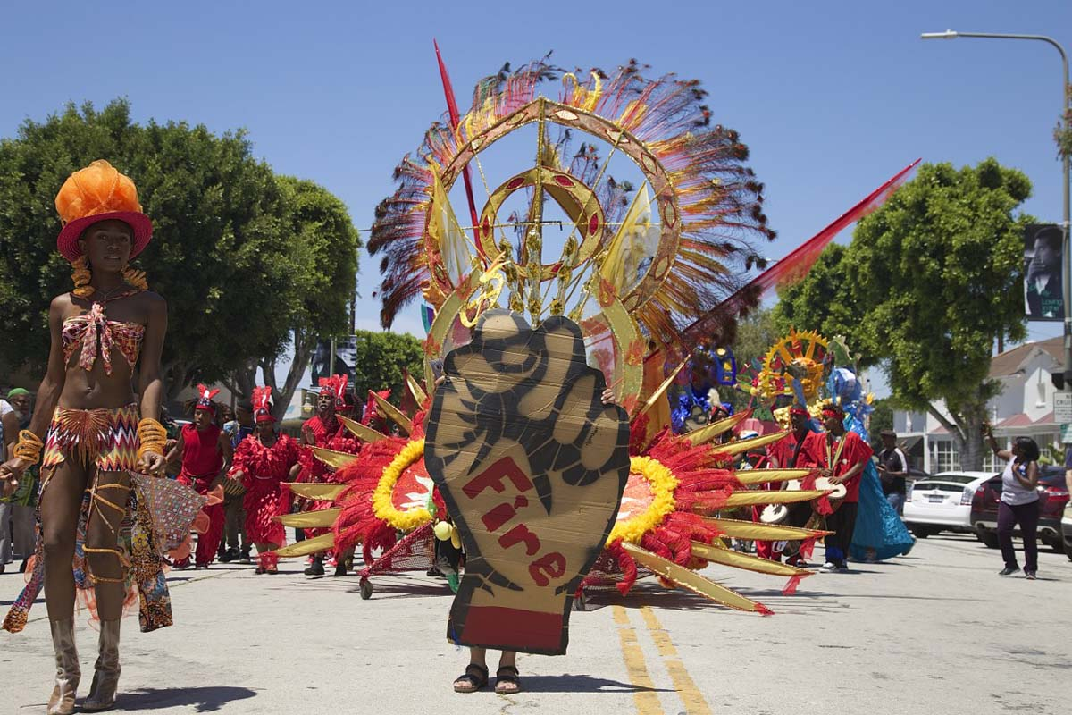 """The 2017 edition of the Day of the Ancestors: Festival of Masks featured bright costumes and bold designs, like this fist emblazoned with the word """"fire."""" 