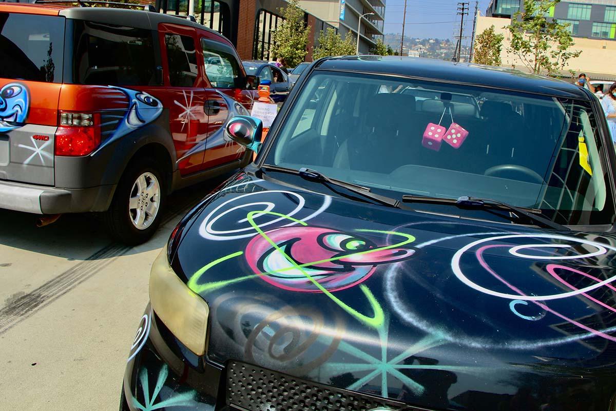 "A black car participating at Kenny Scharf's ""Karbombz!"" car parade September 26, 2020 | Jordan Riefe"