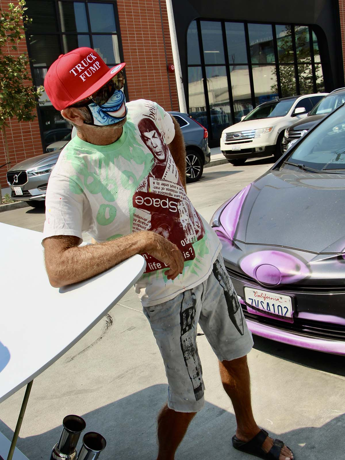 """Kenny Scharf looking at one of his creations at the """"Karbombz!"""" rally September 26, 2020 