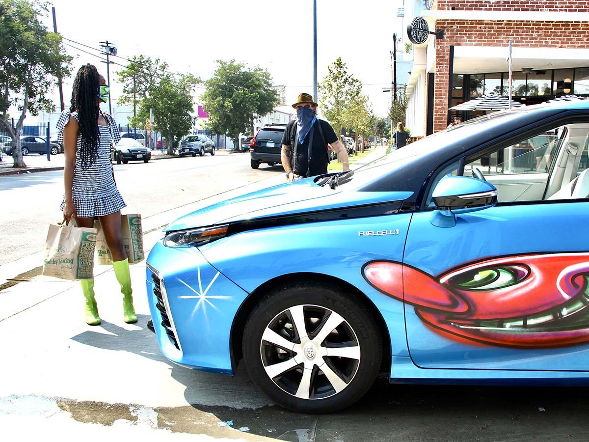 "A blue car participating at Kenny Scharf's ""Karbombz!"" car parade September 26, 2020 | Jordan Riefe"