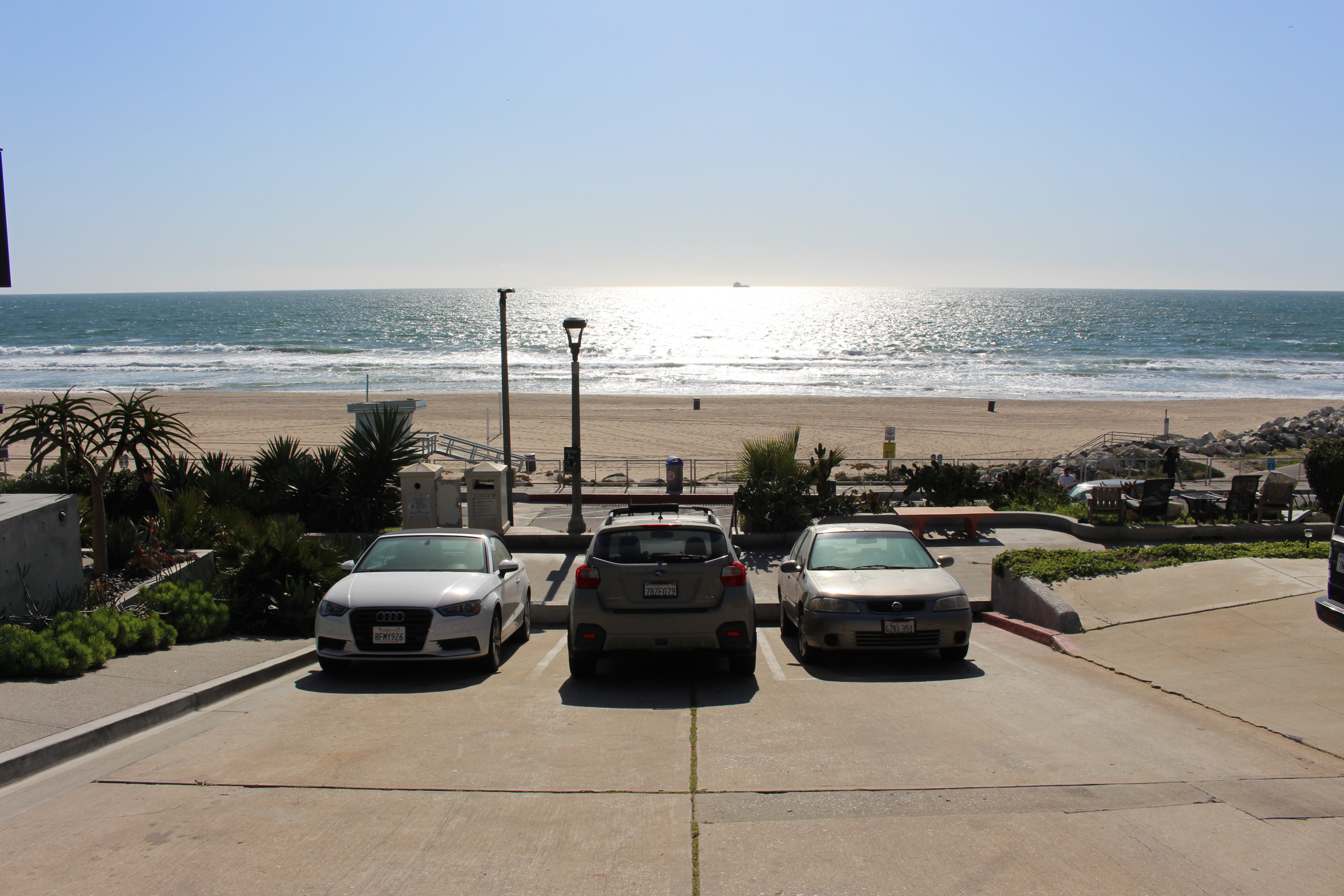Cars parked near the beach, view of the ocean, taken on March 26, 2020 | Karen Foshay