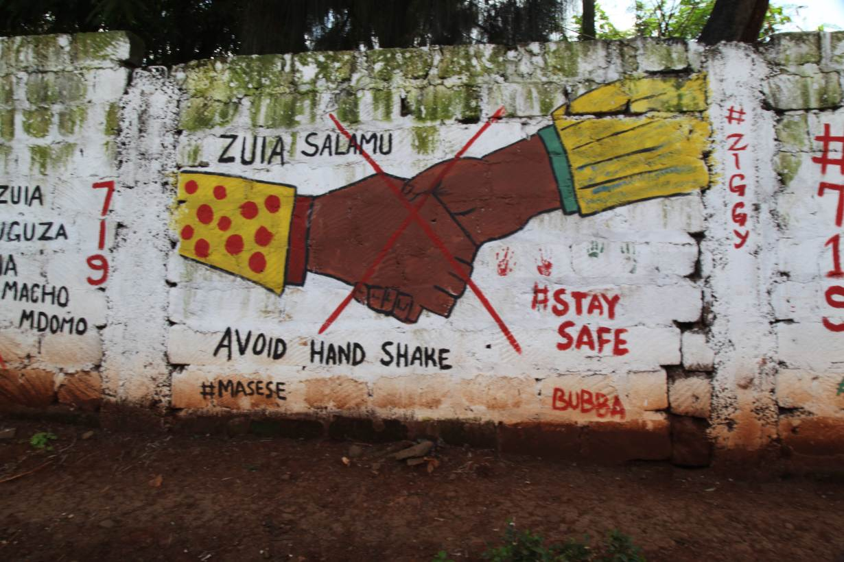 A mural about the COVID-19 pandemic in Kawangware informal settlement in Nairobi, Kenya on May 27, 2020. | THOMSON REUTERS FOUNDATION/Nita Bhalla