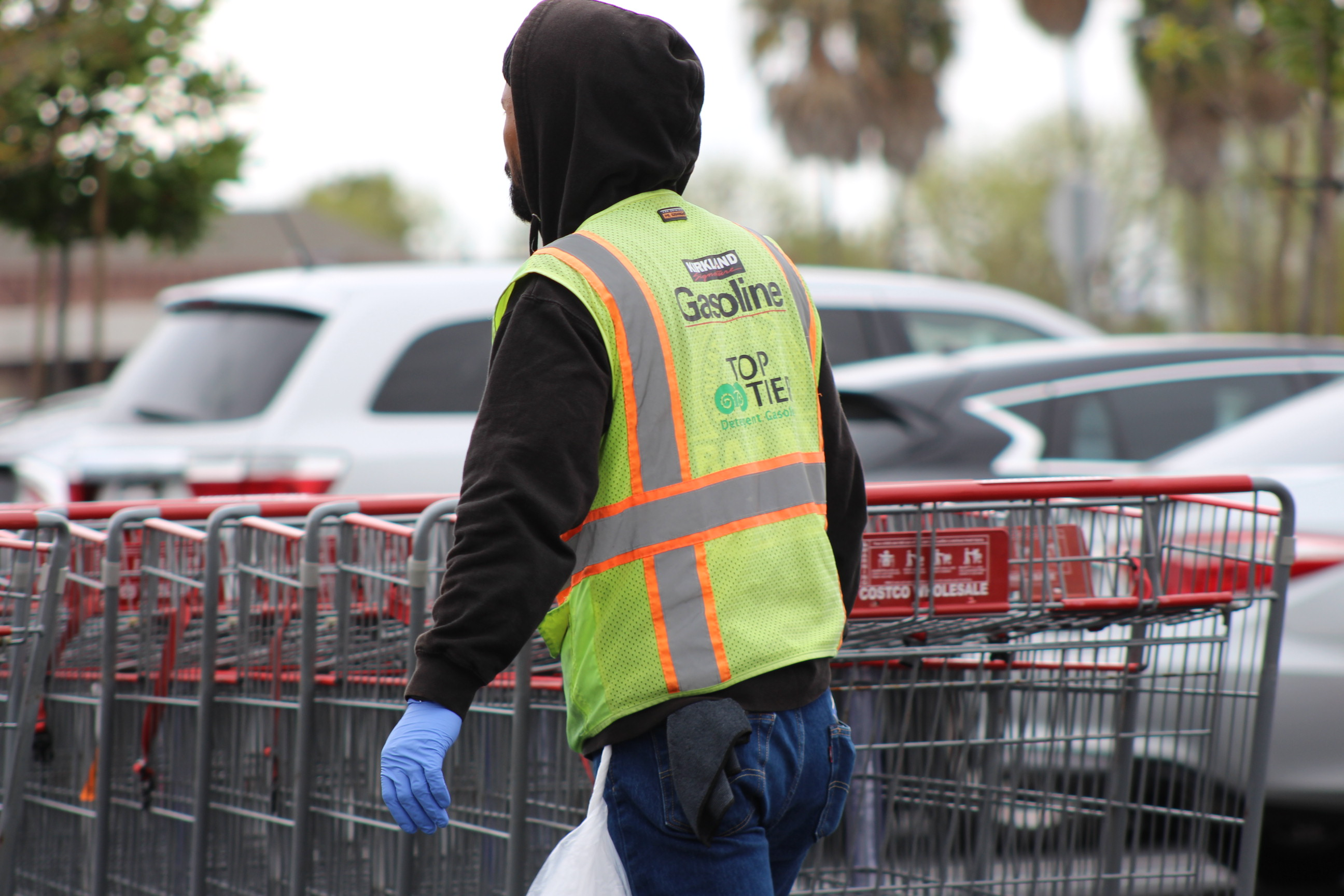 Costco worker wearing gloves during COVID-19 pandemic in parking lot | Karen Foshay