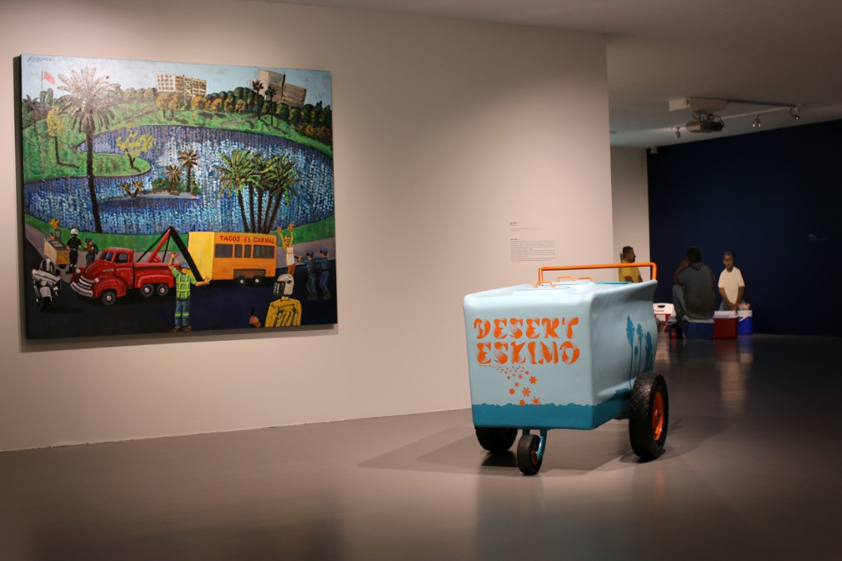 """MacArthur Park, the Arrest of the Taco wagon, an Attack on Culture"" 2010 by Frank Romero and ""Paleta Cart,"" 2004 by Gary Garay 