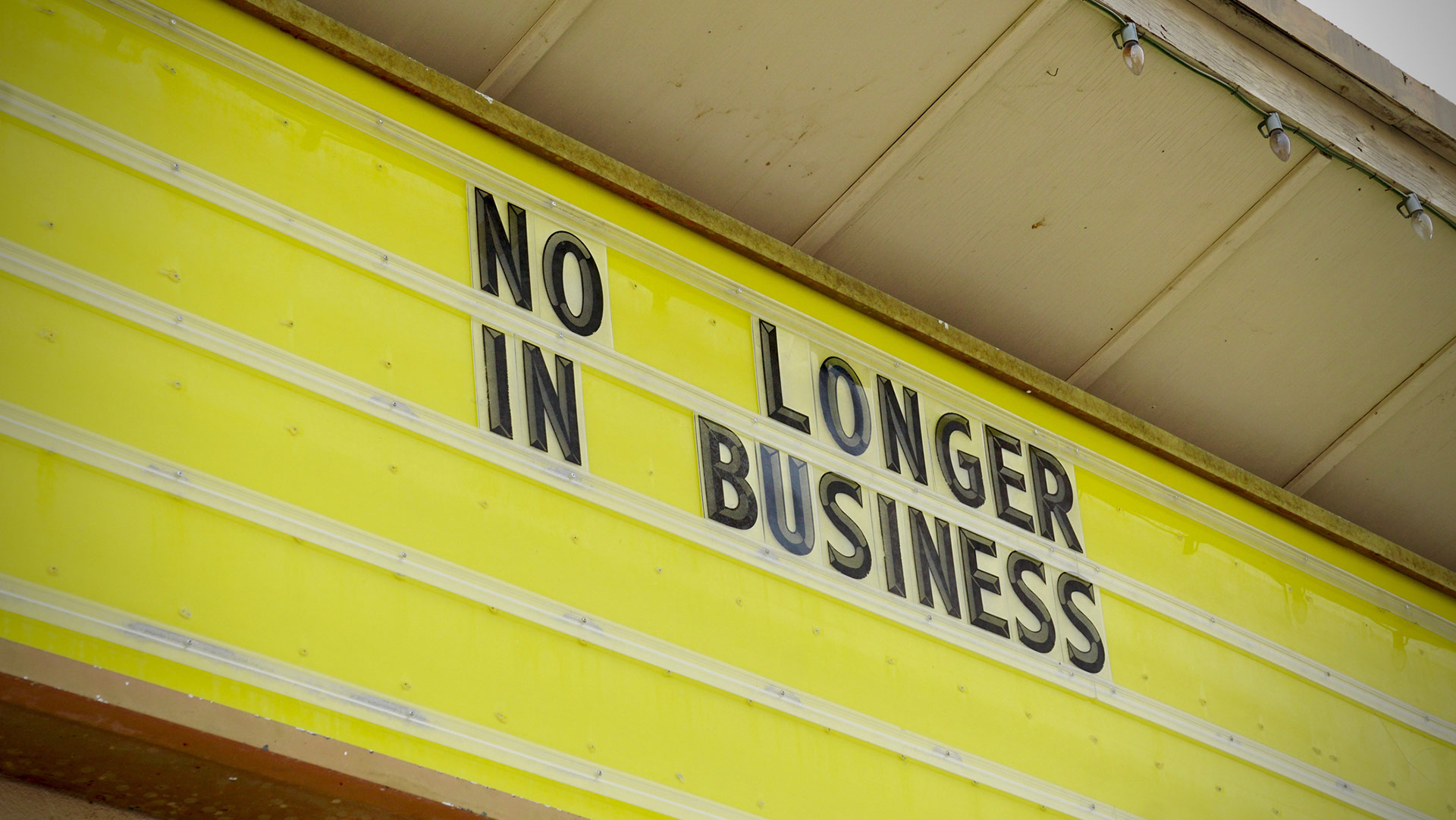 """A marquee reads """"No longer in business."""" 