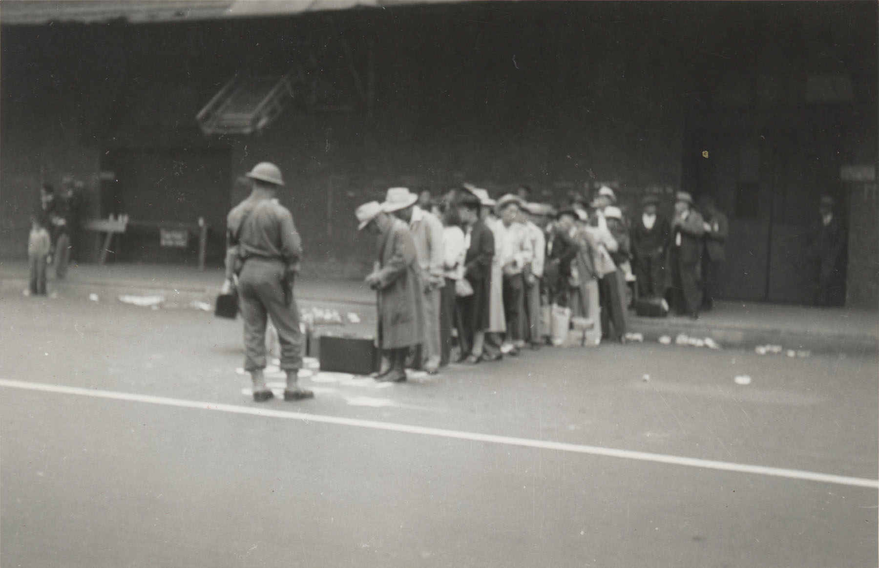JANM-Japanese Americans lined up and under guard on central avenue.jpg