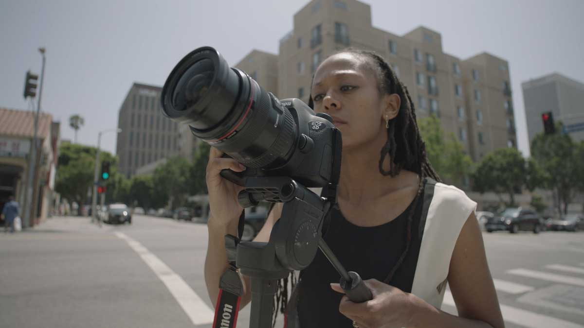 "Janna Ireland taking a photo of a Paul R. Williams work | Still from ""Lost LA"" Paul R. Williams"