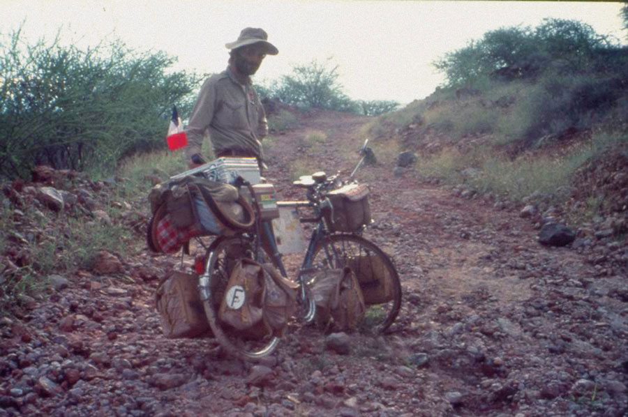 Jöel Lodé on a rocky road in Kenya while traversing the globe on bicycle.