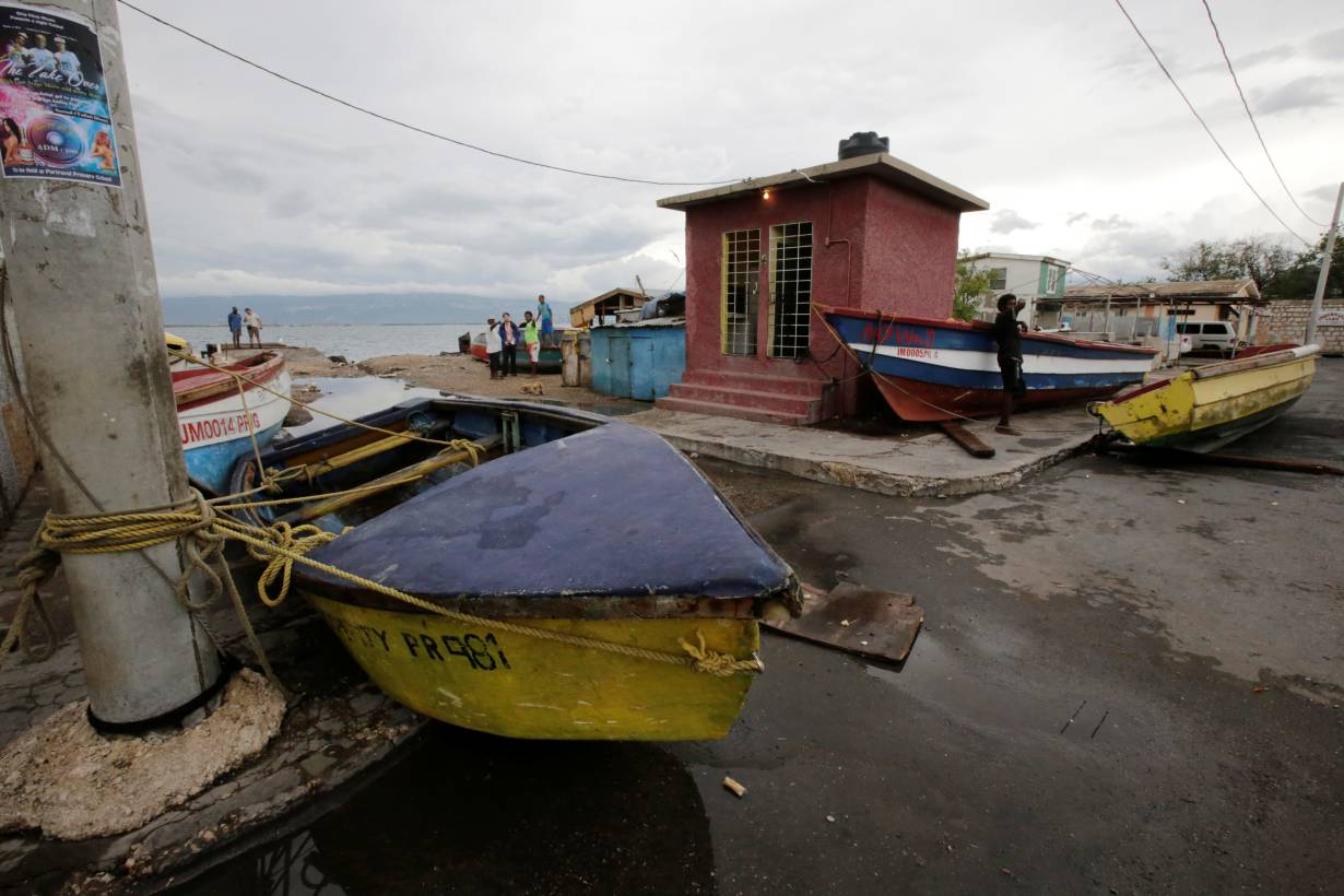 ARCHIVE PHOTO: Boats are secured off as residents look on at Port Royal while Hurricane Matthew approaches in Kingston, Jamaica October 2, 2016. | REUTERS/Henry Romero