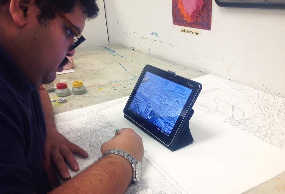 Joe Zaldivar drawing the Eiffel Tower via his iPad and Google Maps
