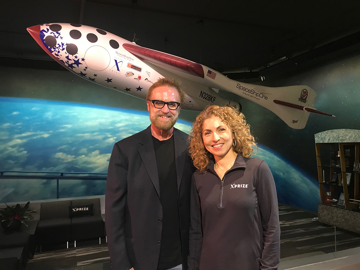 Director Peter Jones and XPRIZE CEO Anousheh Ansari pose in front of a model of SpaceShipOne, which won the Ansari XPRIZE in 2004. | Courtesy of Peter Jones Productions