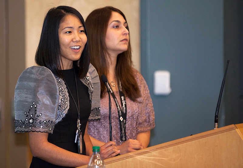 Josephine Santiago-Bond and Alyssa Garcia, of Kennedy Space Center's Asian Pacific American Connection Employee Resource Group speak to attendees at the annual Asian-American Pacific Islander Heritage Month event. | Flickr/NASA Kennedy/Creative Commons