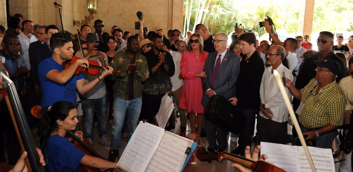 President's Committee delegation arriving in Cuba with Joshua Bell playing with Cuban students. | Courtesy of the President's Committee on the Arts and the Humanities