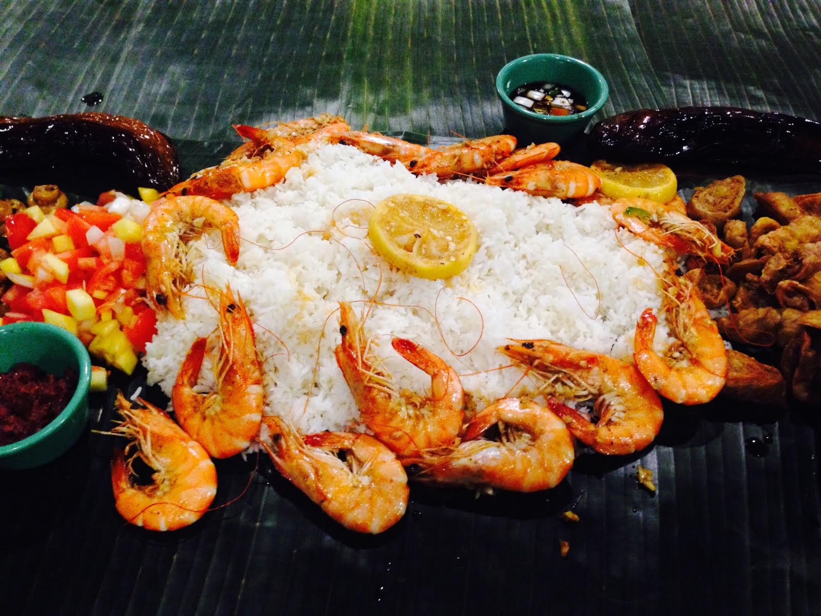 Kamayan dining with grilled fish, boneless milkfish and mango salsa  | Daniel Belen