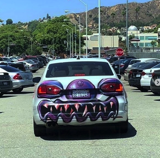 """A Volkswagen sedan bombed by Kenny Scharf for his """"Karbombz!"""" project 