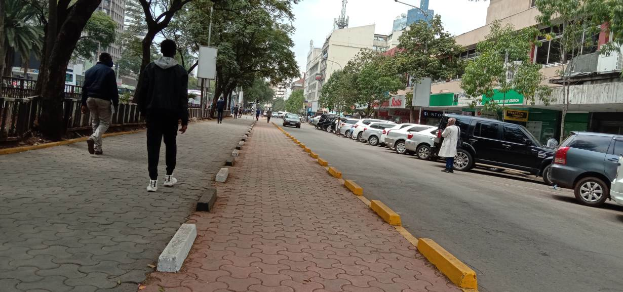 Passersby walk near a section of newly build pedestrian walkway along Kenyatta Avenue in the center of Nairobi, July 29, 2020. | Thomson Reuters Foundation/Wesley Langat