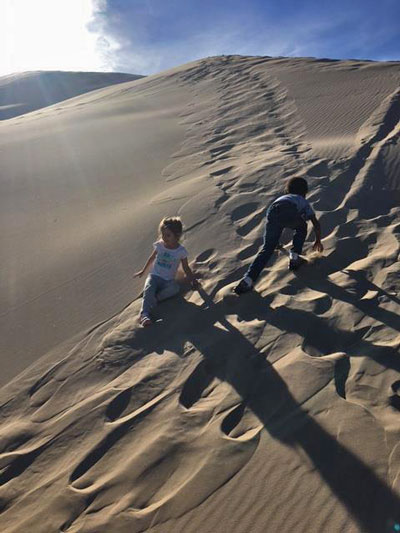 The younger you get to know the parks, the more you'll recognize their value. Kids at Kelso Dunes, Mojave National Preserve | Photo: Seth Shteir