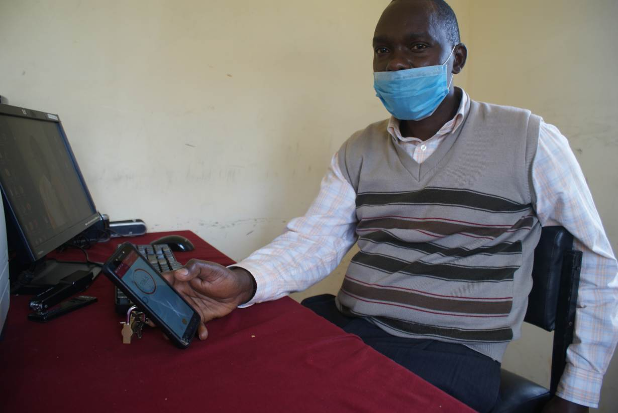 Philip Ndegwa, the Kangema RANET station administrator, demonstrates how to tune in the radio frequency at the station's office in Kangema, Kenya, on July 31, 2020. | Thomson Reuters Foundation/Kagondu Njagi