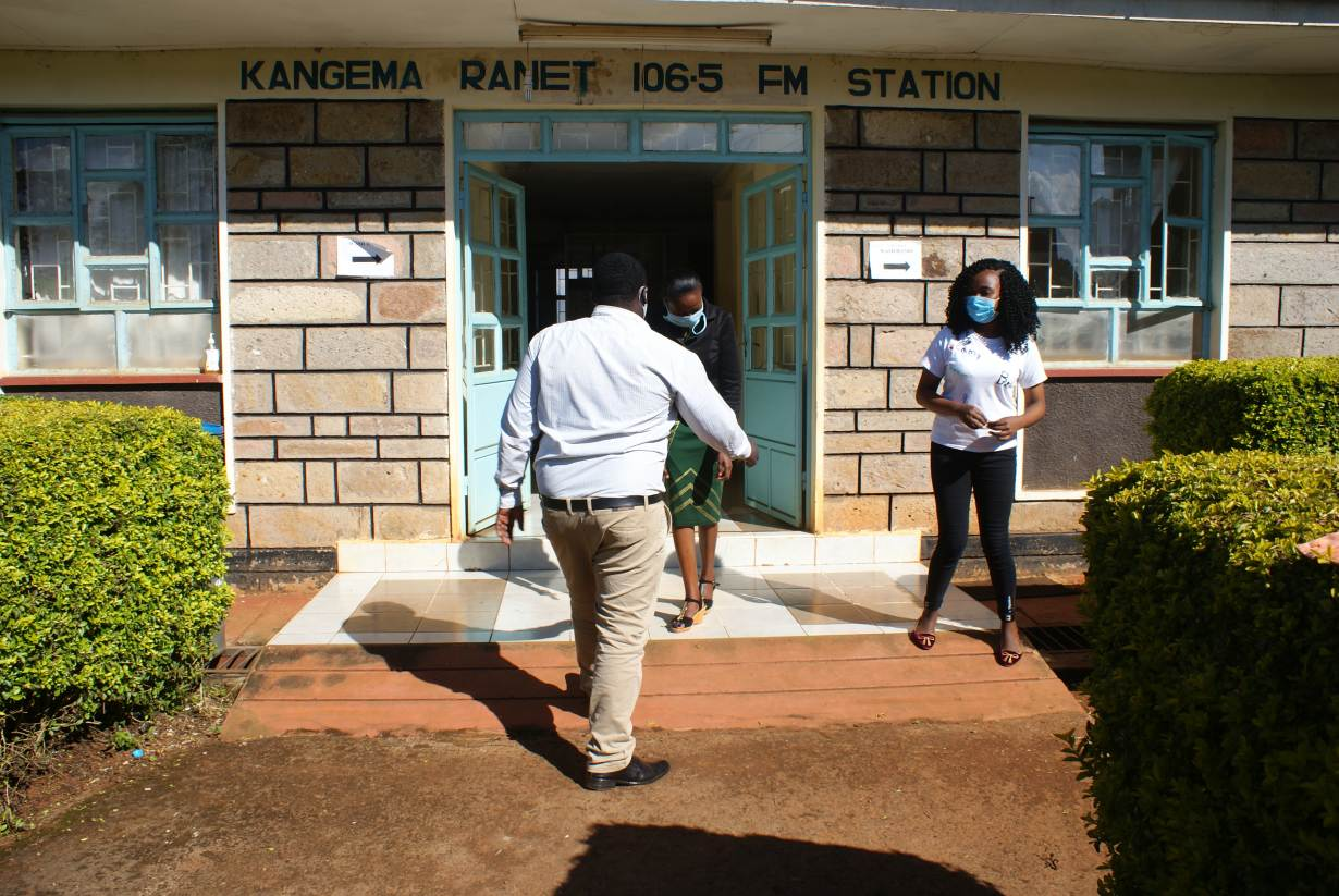 Kangema RANET staff near the door of the radio station in Kangema, Kenya, on July 31, 2020. | Thomson Reuters Foundation/Kagondu Njagi