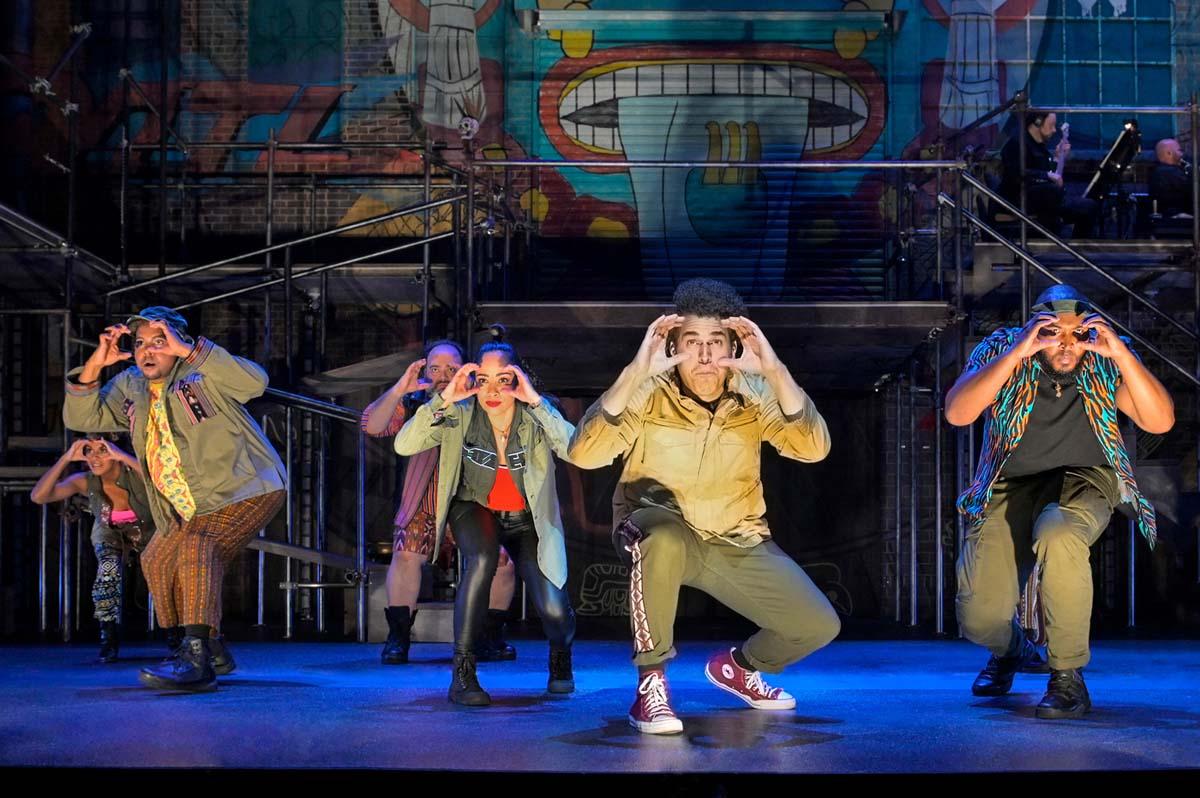 "The cast of La Jolla Playhouse's co-world premiere of ""Kiss My Aztec!"" Book by John Leguizamo and Tony Taccone, music by Benjamin Velez, lyrics by David Kamp, Benjamin Velez and John Leguizamo, directed by Tony Taccone. |Kevin Berne"