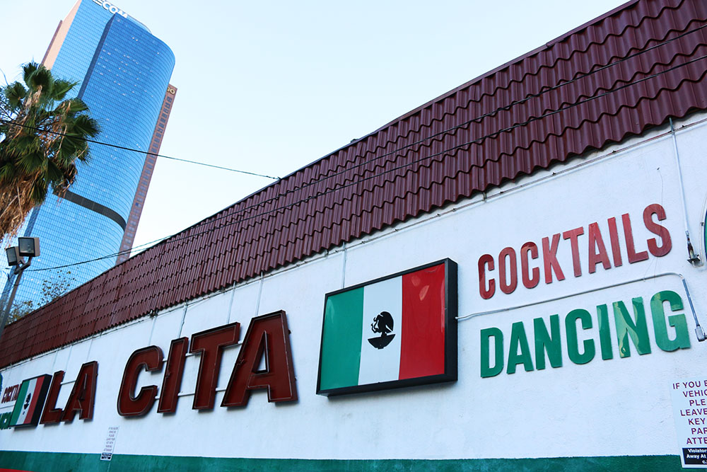 "La Cita Sign with LA skyscraper in the back: Mexican flag, "":Cocktails,"" ""Dancing"""