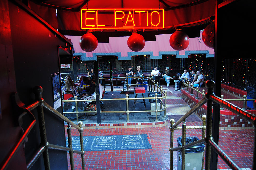 "La Cita's patio, with neon sign reading ""El Patio."" 