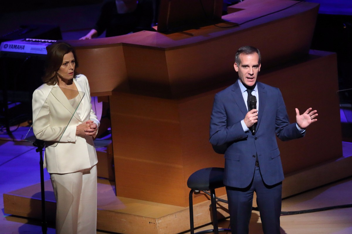 "Sigourney Weaver and Mayor Eric Garcetti are cast on the 2017 performance of ""War of the Worlds."" 