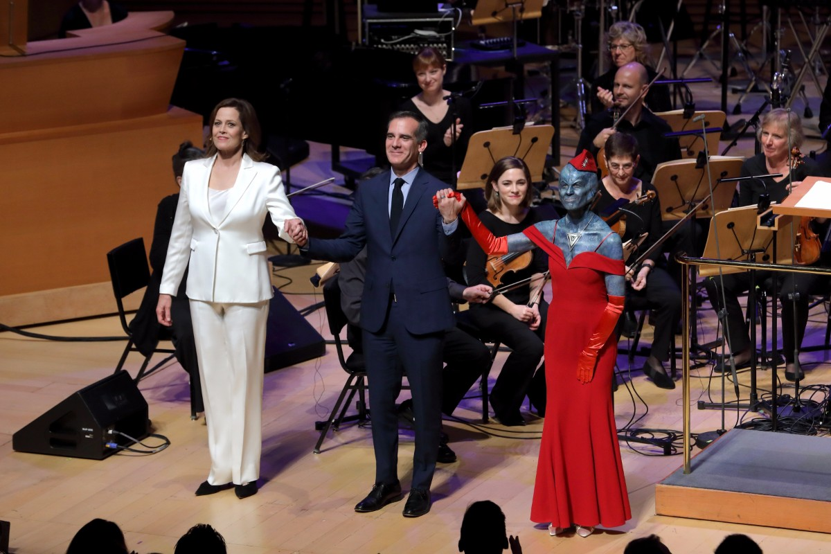 "Sigourney Weaver, Mayor Eric Garcetti and Hila Plitmann are cast on the 2017 performance of ""War of the Worlds."" 
