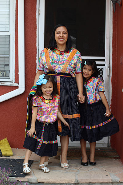 Floridalma Boj Lopez, age 32, with her daughters Soledad Boj-Lopez, age 6, and Luna Boj-Lopez, age 4.  La familia Boj-Lopez is from Xelaju Noj (Quetzaltengo), Guatemala and now live in East L.A.  | Jasleen Reyes / Courtesy of Las Fotos Project