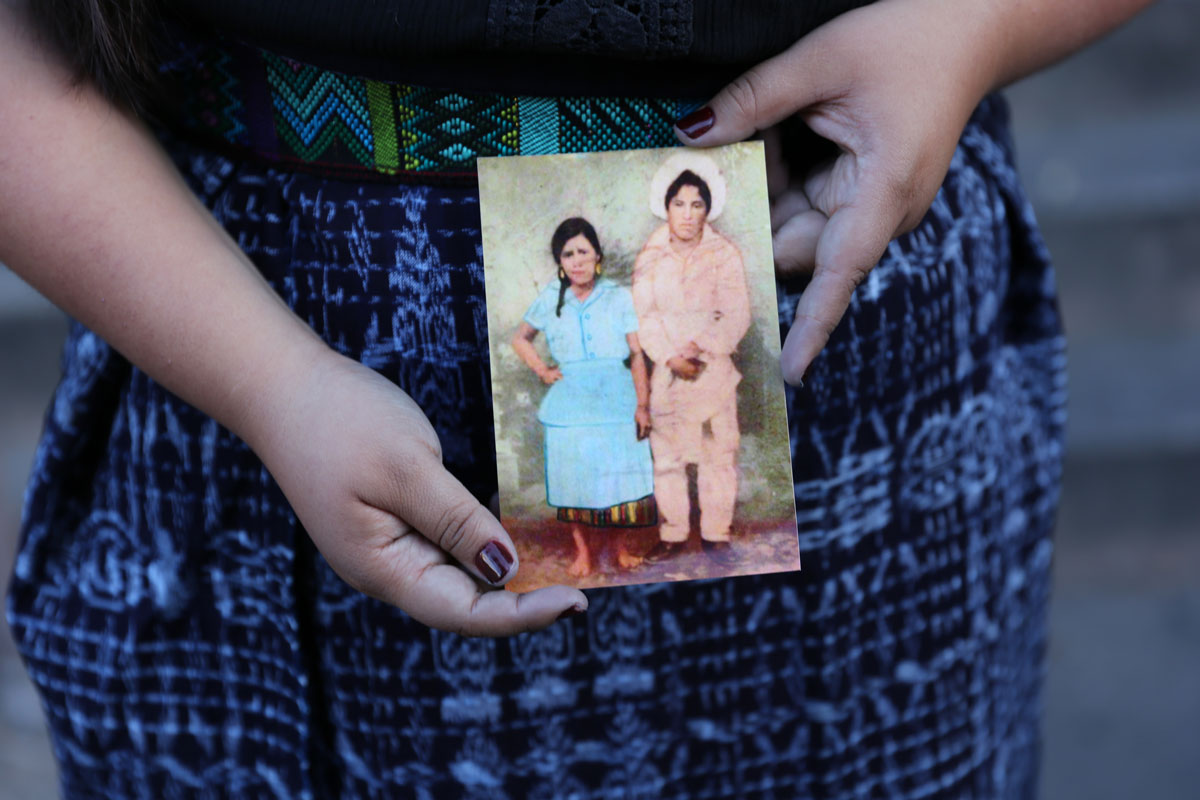 Maricela Lopez, age 26  Maricela is holding a picture of her grandmother.   Jessica Oxlaj / Courtesy of Las Fotos Project