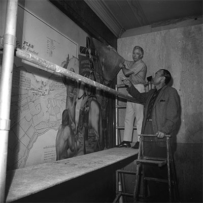 Artist Edward Biberman watching a worker remove his mural from the Los Angeles Federal Building, 1965 | Los Angeles Times Photographic Archive at UCLA Library