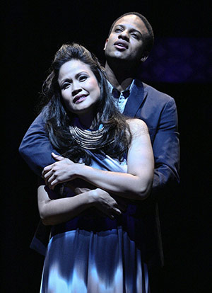 """Lovers Anatoly (Elijah Rock) and Florence (Joan Almedilla) in the East West Players production of """"Chess,"""" directed by Tim Dang with music by Benny Andersson and Björn Ulvaeus of the pop group ABBA, lyrics by Ulvaeus and Tim Rice and a book by Rice."""
