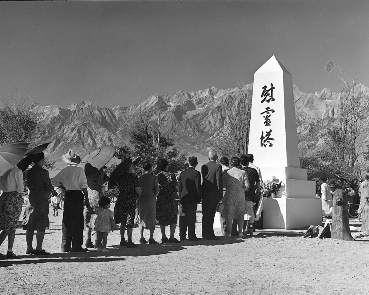 People at the Manzanar grave site | Courtesy of Toyo Miyatake Studio