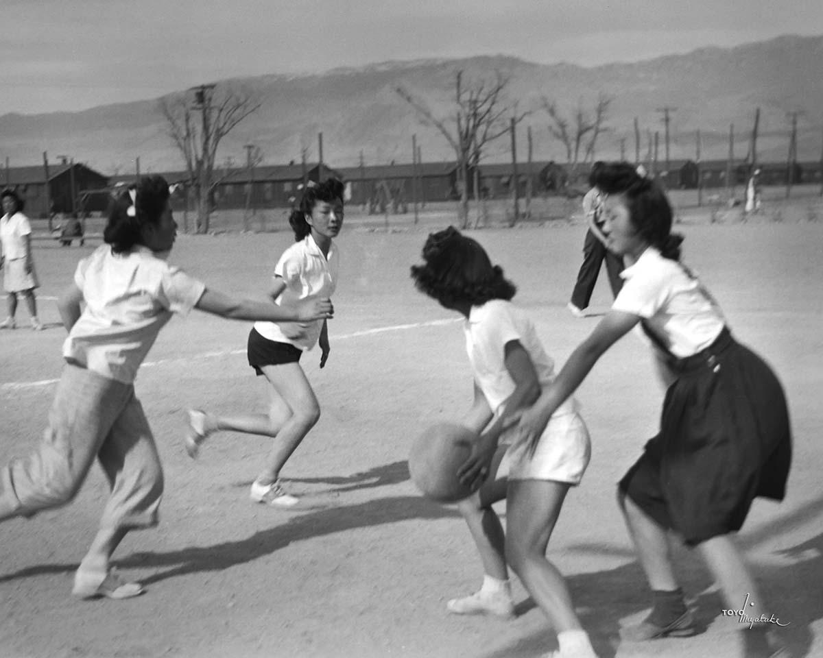 Japanese American women playing volleyball at Manzanar | Courtesy of Toyo Miyatake Studio