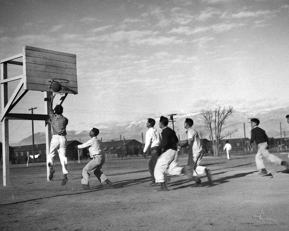 Japanese American men playing basketball at Manzanar | Courtesy of Toyo Miyatake Studio