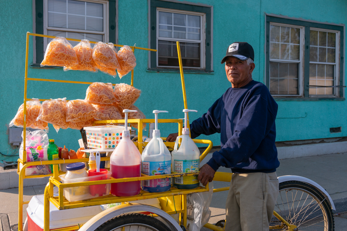Manuel Hernandez is a streeet vendor selling snacks on a bike-operated vehicle on the streets of Fresno. | Neil Chowdhury