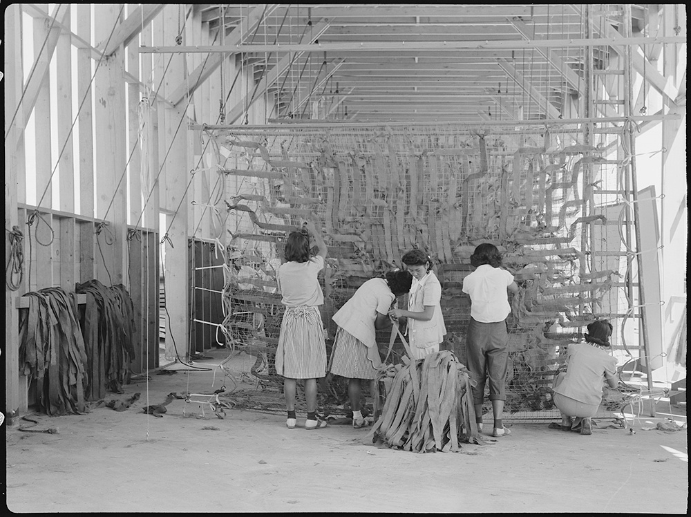 In her performance piece, Tania Candani will reference Japanese American internment in Manzanar. Here, women at the Manzanar Relocation center make camouflage nets. | Courtesy of Wikimedia Commons and the National Archives and Records