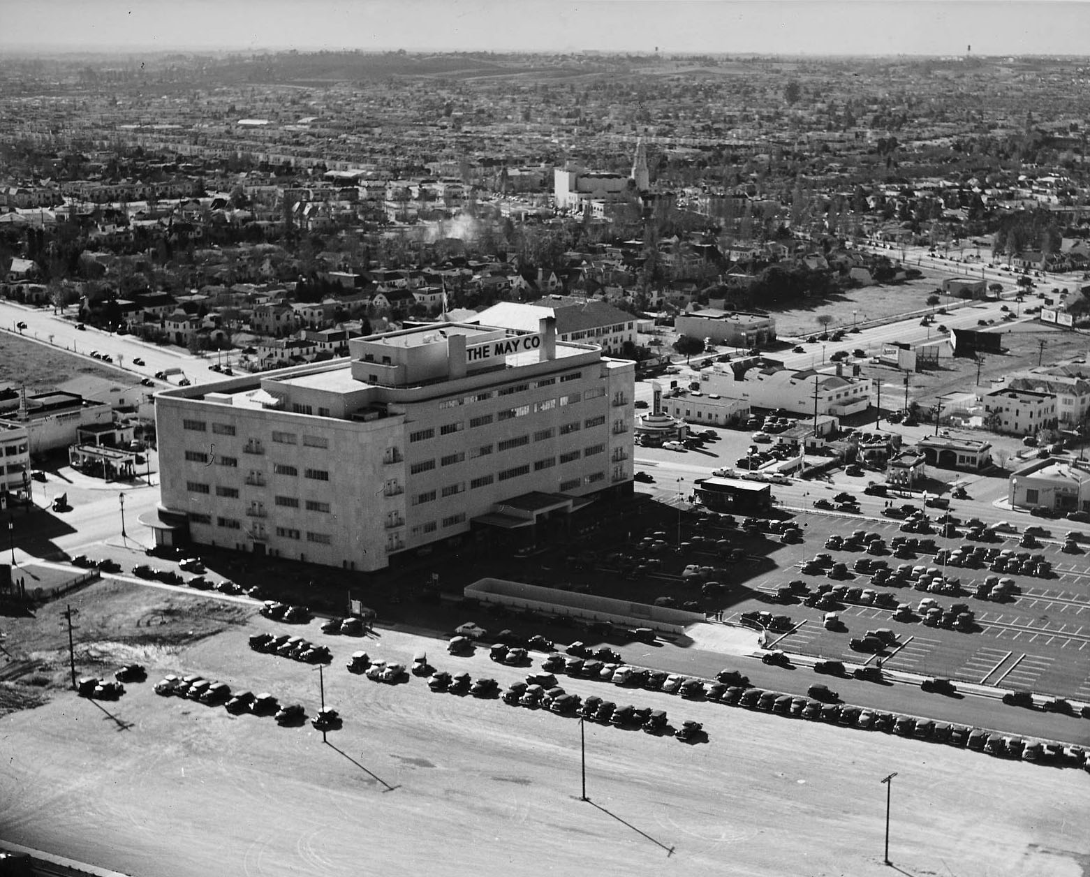 1940 Aerial view of the recently finished May Company at Wilshire and Fairfax. Note the expansive parking lot behind the department store.